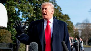President Donald Trump speaks to reporters outside the White House on Saturday.