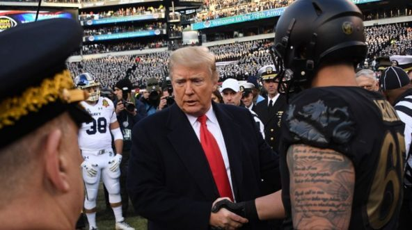 President Donald Trump shakes hands with one of the captains of the Army Black Knights before Saturday's Army-Navy football game in Philadelphia.