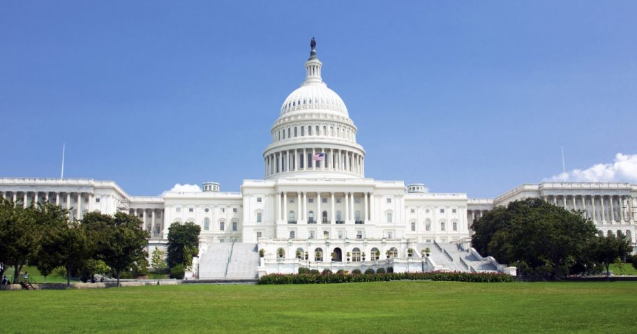 U.S. Capitol building against a blue sky.