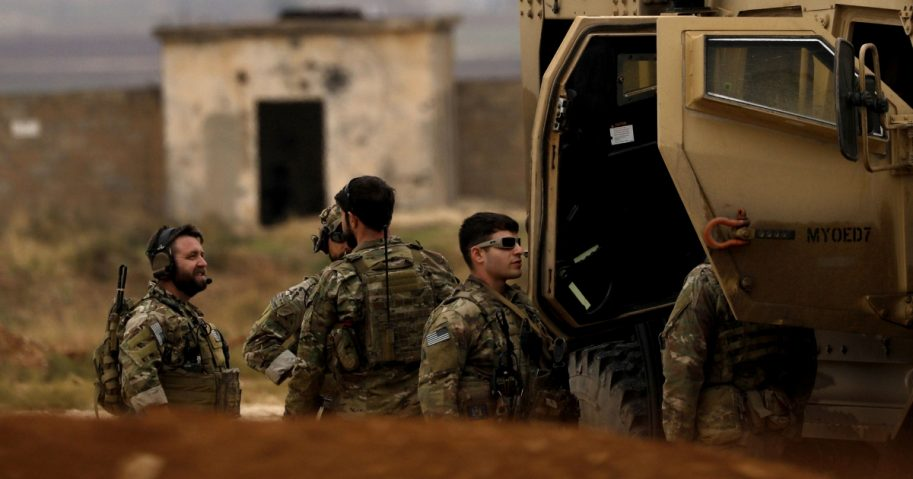 U.S. troops and members of the Syrian Democratic Forces patrol the Kurdish-held town of Al-Darbasiyah in northeastern Syria on Nov. 4.