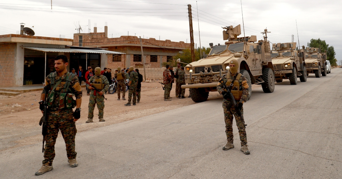 U.S. troops and members of the Syrian Democratic Forces patrol the Kurdish-held town of al-Darbasiyah in northeastern Syria on Nov. 4.