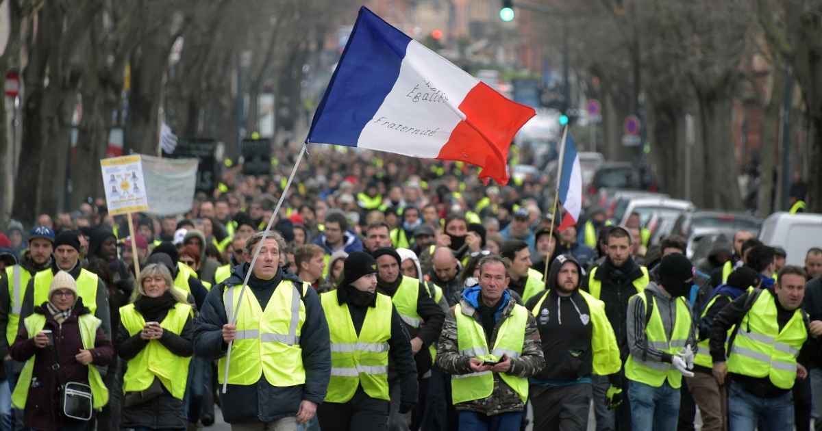 People march during a 'yellow vest' (gilets jaunes) anti-government demonstration in Toulouse, southern France, on Dec. 29, 2018.