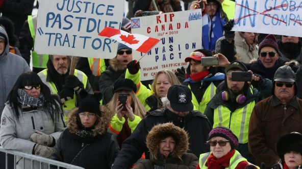 Canadians, many in yellow vests like those worn by anti-government protesters in France, demonstrate in Ottawa on Dec. 8.