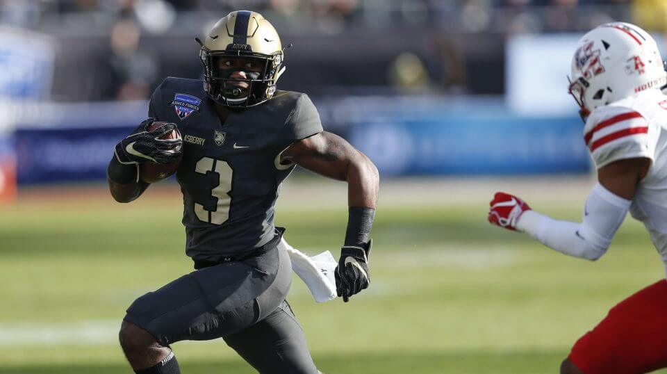 Army running back Jordan Asberry (3) rushes the ball against Houston during the first half of Armed Forces Bowl NCAA college football game on Saturday in Fort Worth, Texas.