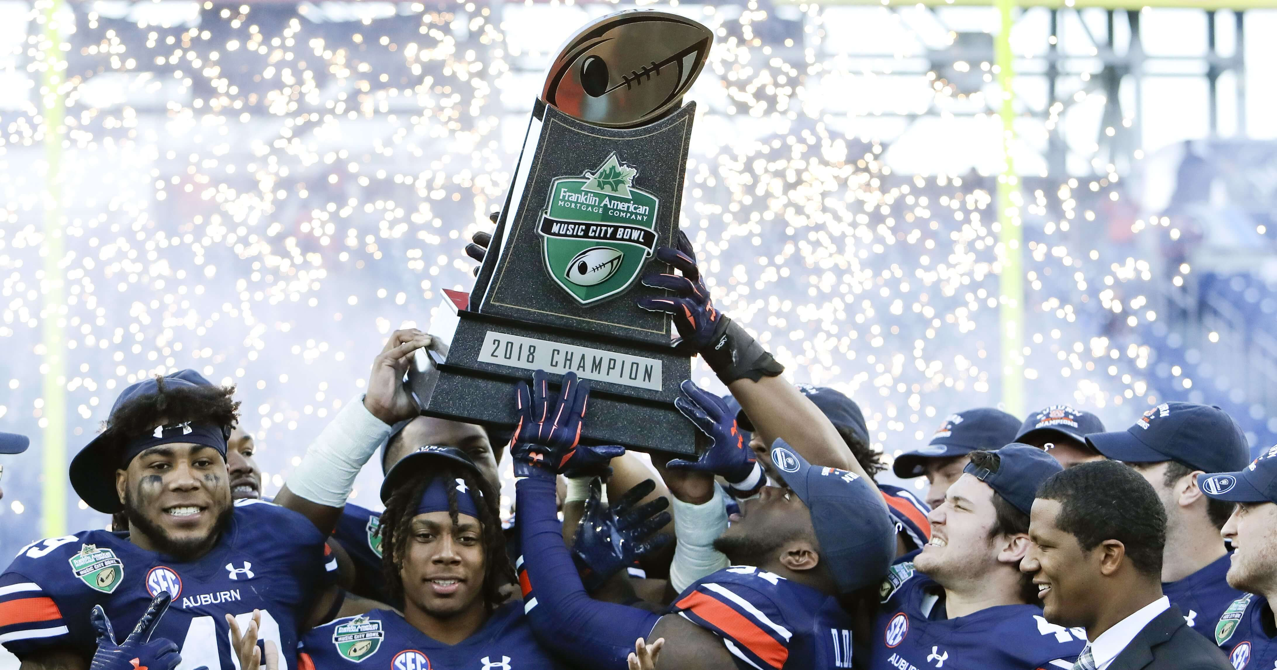 Auburn players celebrate after defeating Purdue to win the Music City Bowl on Friday in Nashville, Tennessee.