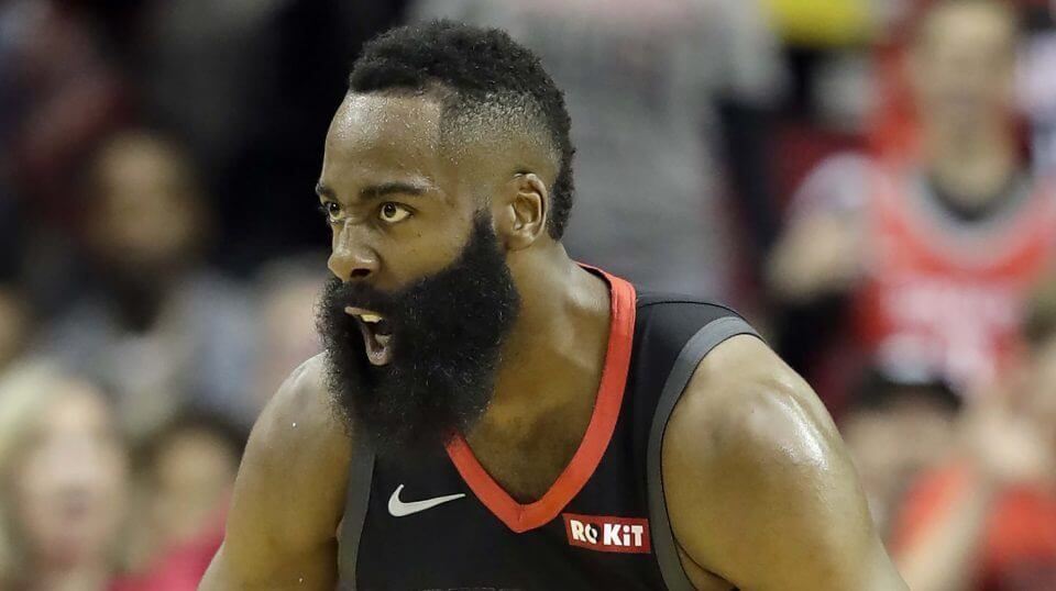 Houston Rockets' James Harden reacts after dunking the ball against the Los Angeles Lakers in the first half Thursday in Houston.