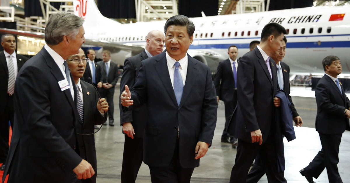 Chinese President Xi Jinping and Ray Conner, president and CEO Boeing Commercial Airplanes, tour the Boeing assembly line.