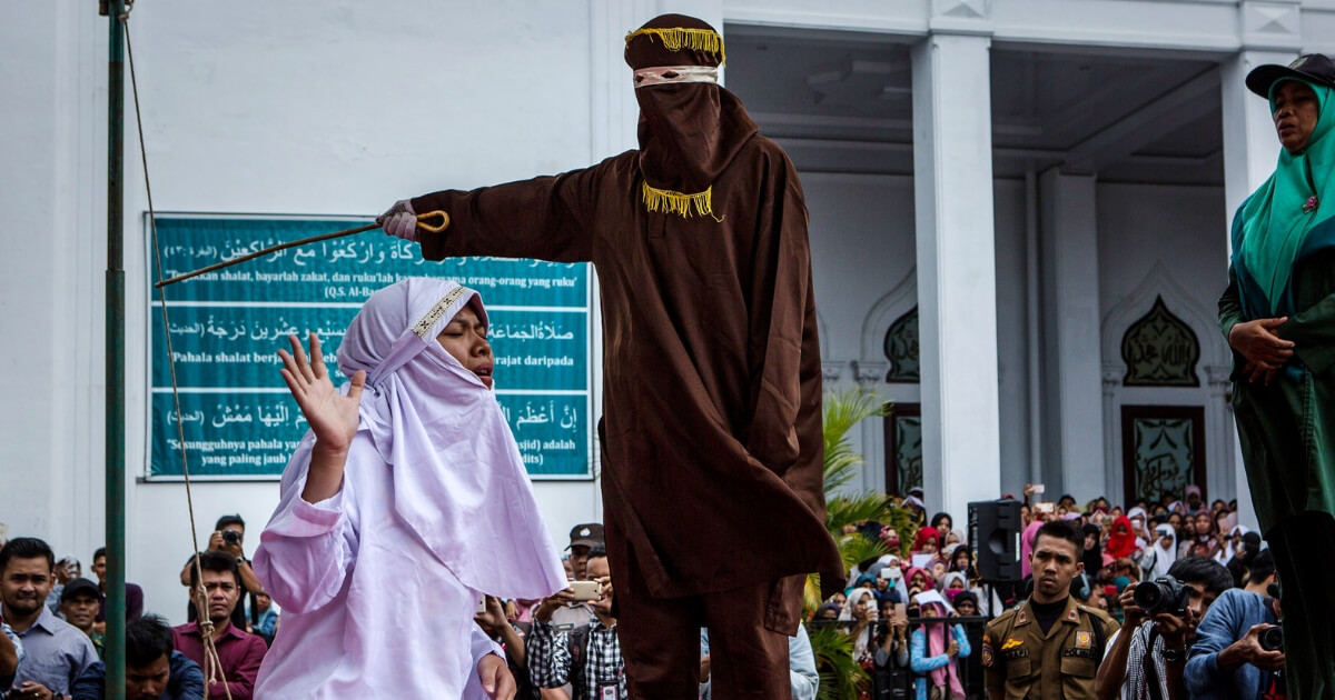Woman is caned in Indonesia for breaking Shariah law.