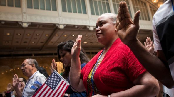New U.S. citizens recite the Oath of Allegiance during naturalization ceremony at the New York Public Library, July 3, 2018 in New York City.