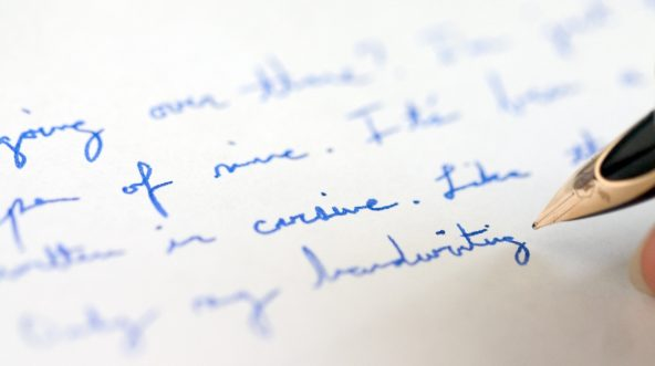 Blue cursive handwriting with pen.