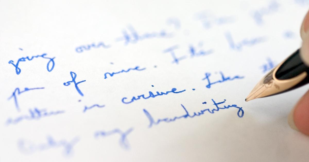 Blue cursive handwriting with pen.