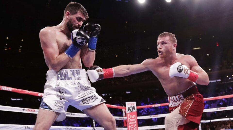 Mexico's Canelo Alvarez, right, punches England's Rocky Fielding during the second round of a WBA super middleweight championship boxing match on Saturday in New York. Alvarez stopped Fielding in the third round.