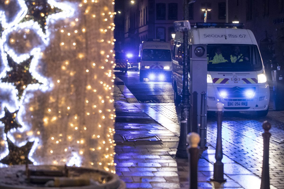 Police vehicles move at the center of the city of Strasbourg following a shooting, eastern France, Tuesday Dec. 11, 2018. A man who had been flagged as a possible extremist sprayed gunfire near the city of Strasbourg's famous Christmas market Tuesday, killing three people, wounding 12 and sparking a massive manhunt.