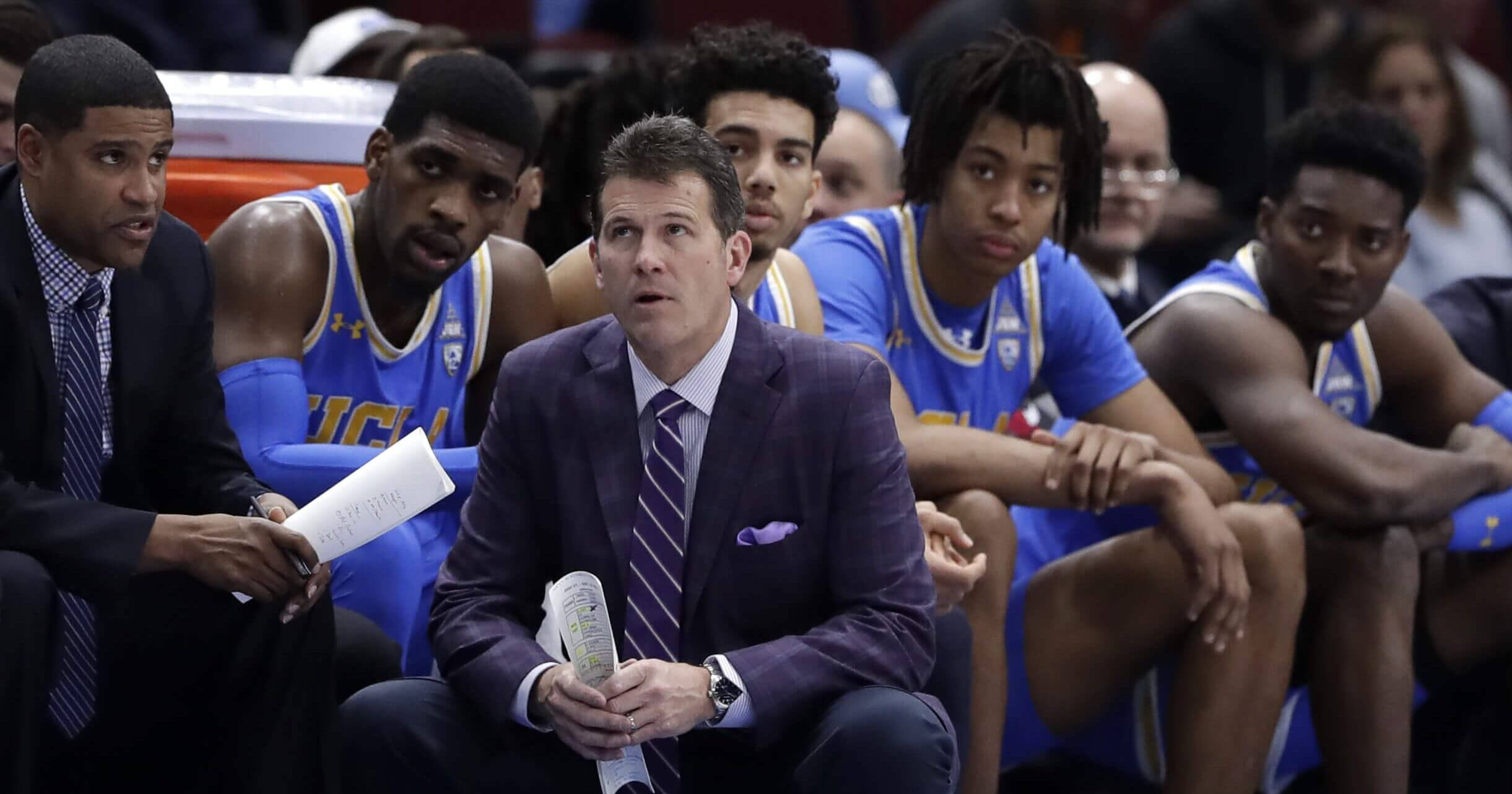 Coach Steve Alford and UCLA players watch during the second half of a game against Ohio State on Dec. 22.