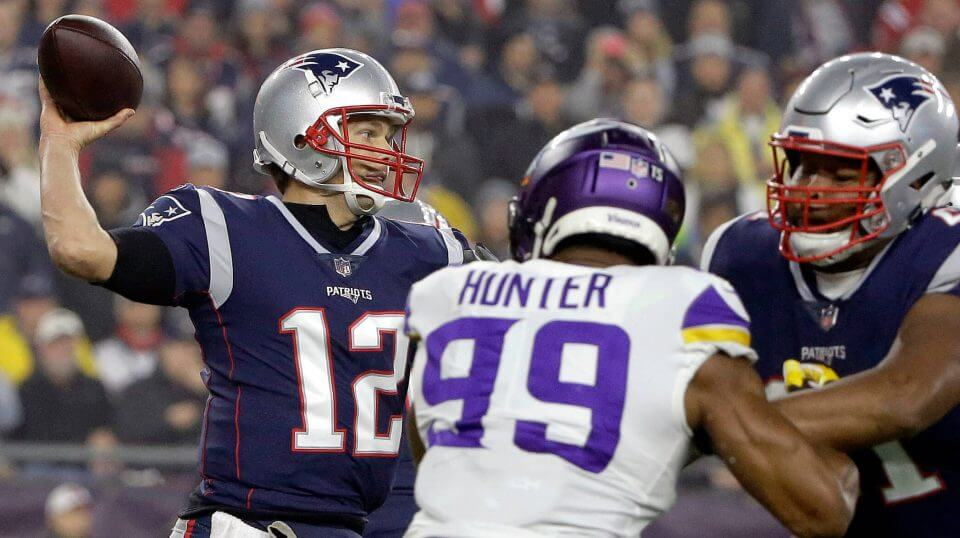 New England Patriots quarterback Tom Brady passes under pressure from Minnesota Vikings defensive end Danielle Hunter during Sunday's game at New England.
