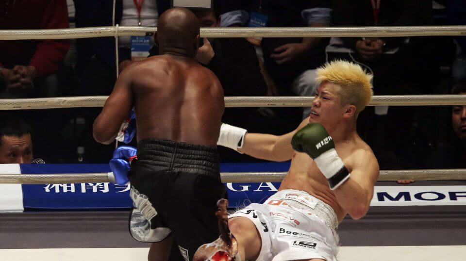 Japanese kickboxer Tenshin Nasukawa lies on the mat after being knocked out by Floyd Mayweather Jr. during first round of their three-round exhibition match on New Year's Eve, at Saitama Super Arena in Saitama, north of Tokyo, on Dec. 31, 2018.