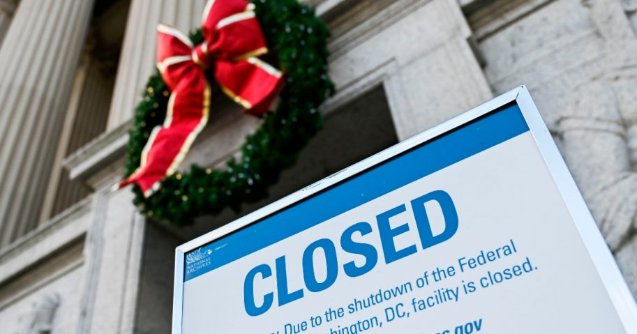 A sign is displayed at the National Archives building that is closed because of a US government shutdown in Washington, DC.