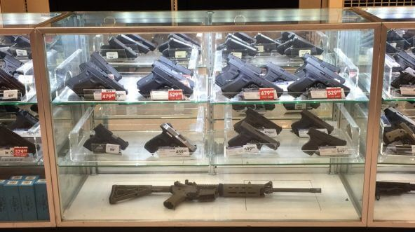Guns in a display case at a store in Monroe, Louisiana.