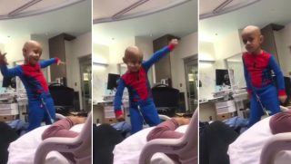 "A little boy busts a move to ""Bad"" by Michael Jackson."