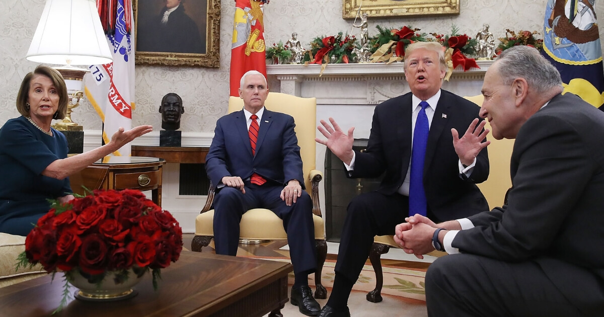 President Donald Trump argues about border security with Senate Minority Leader Chuck Schumer and House Minority Leader Nancy Pelosi as Vice President Mike Pence sits nearby in the Oval Office.