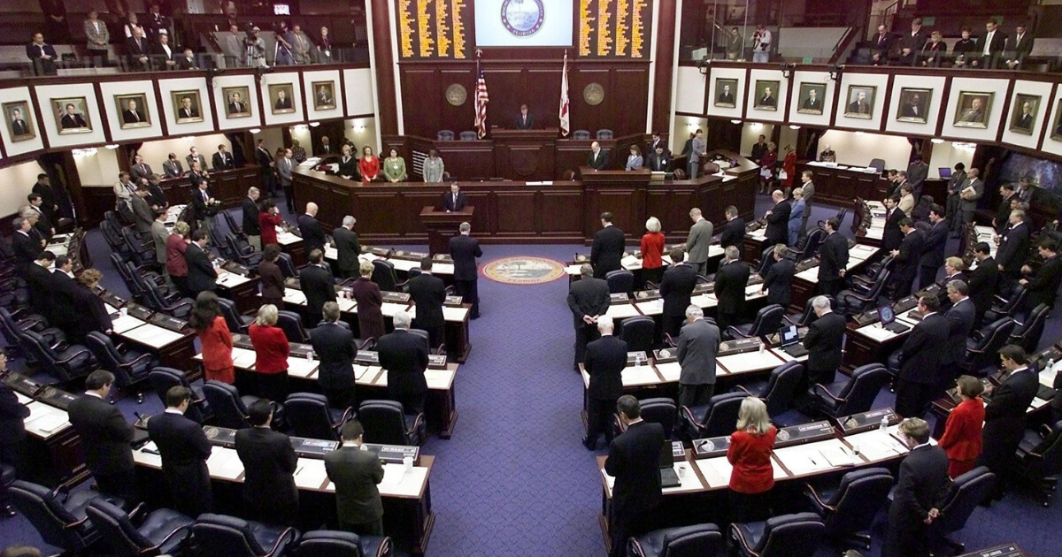 Members of the Florida House bow their heads in prayer at the opening of the historic special session of the Florida State Legislature on Dec. 8, 2000.