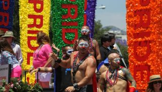 People ride on a float in the L.A. Pride Parade in West Hollywood, California.
