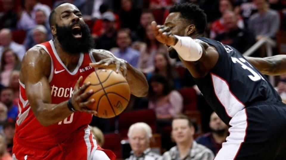 The Houston Rockets' James Harden drives past the Washington Wizards' Jeff Green during Wednesday's game in Houston.