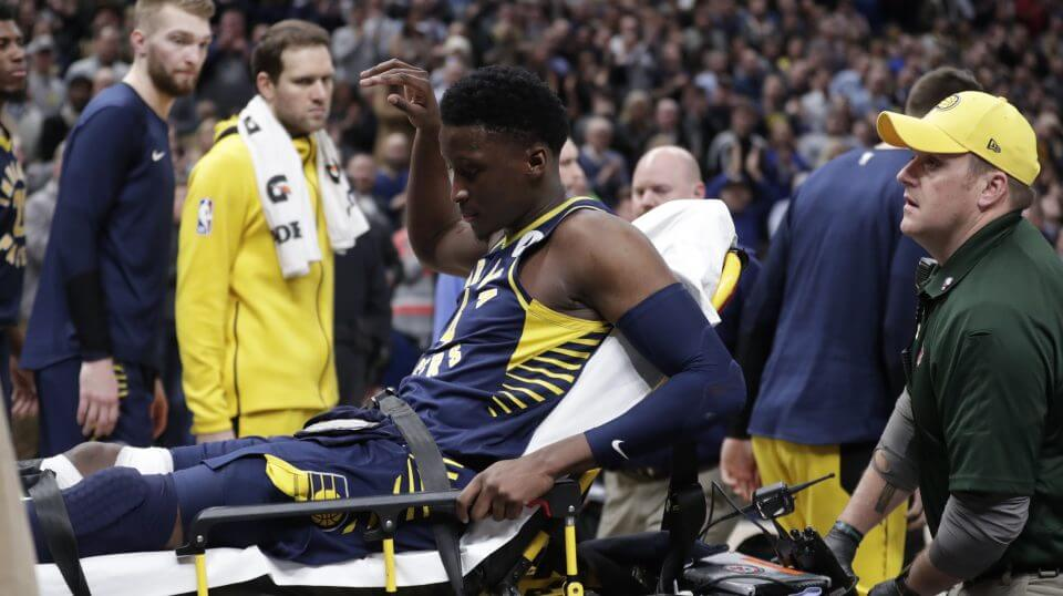 Indiana Pacers guard Victor Oladipo is taken off the court on a stretcher after he was injured during the first half of the team's game against the Toronto Raptors in Indianapolis on Wednesday.