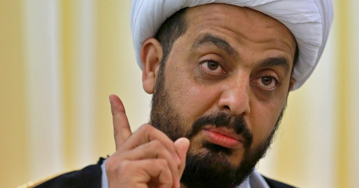 Qais al-Khazali, the leader of the militant Shiite group Asaib Ahl al-Haq, or League of the Righteous, speaks during an interview with The Associated Press in Baghdad, Iraq.