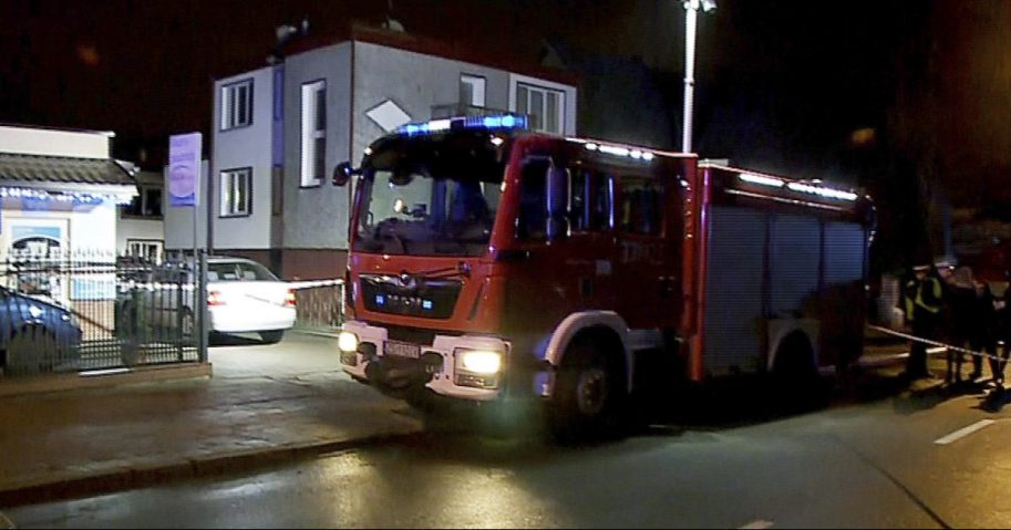 """A fire engine stands outside an """"Escape Room"""" game location in Koszalin, northern Poland, on Jan. 4, 2019"""