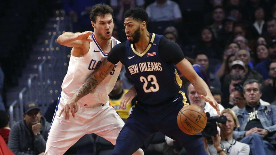 New Orleans Pelicans star Anthony Davis, right, dribbles against the Los Angeles Clippers' Danilo Gallinari during a Jan. 14 game in Los Angeles.