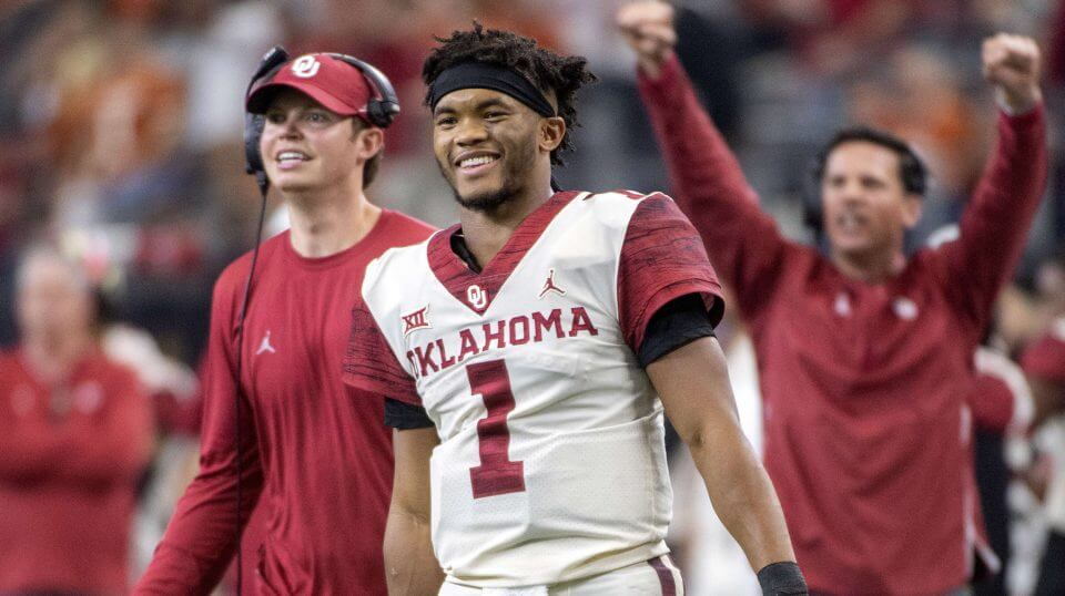 Oklahoma quarterback Kyler Murray celebrates on the sidelines after throwing a touchdown pass against Texas in the Big 12 championship game. Murray is one of a record number of college football players bypassing their remaining years of eligibility to enter the NFL draft.