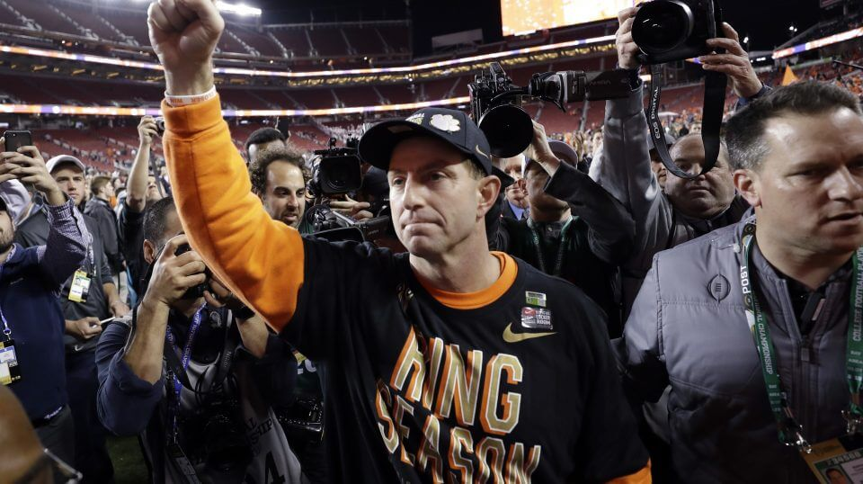 Clemson football coach Dabo Swinney celebrates Monday night after his Tigers crushed Alabama to finish 15-0 and win the national championship.