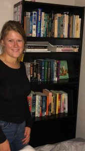 Earley is pictured with her growing library.