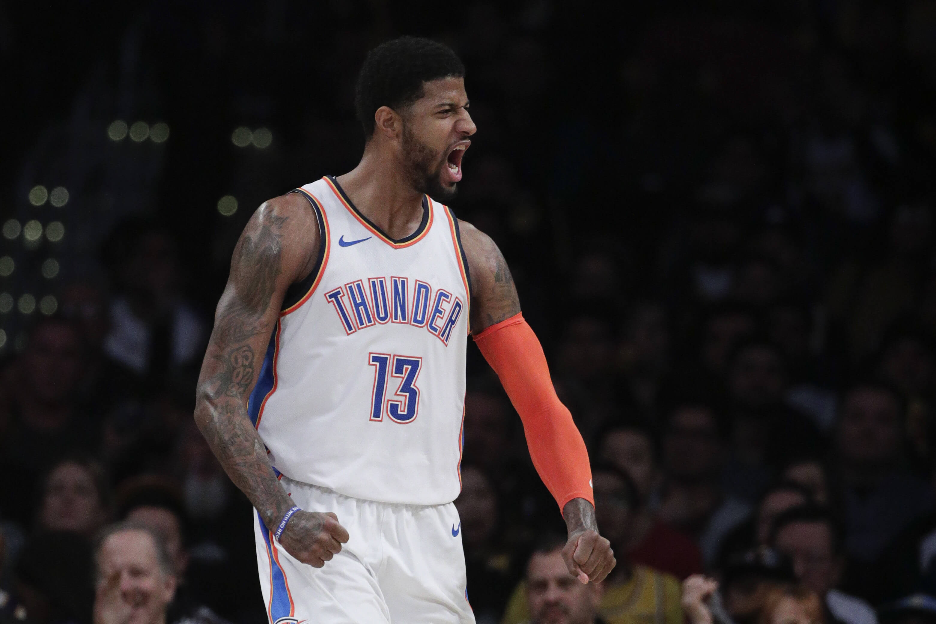 Oklahoma City Thunder's Paul George reacts after making a basket during the second half against the Lakers on Wednesday in Los Angeles.