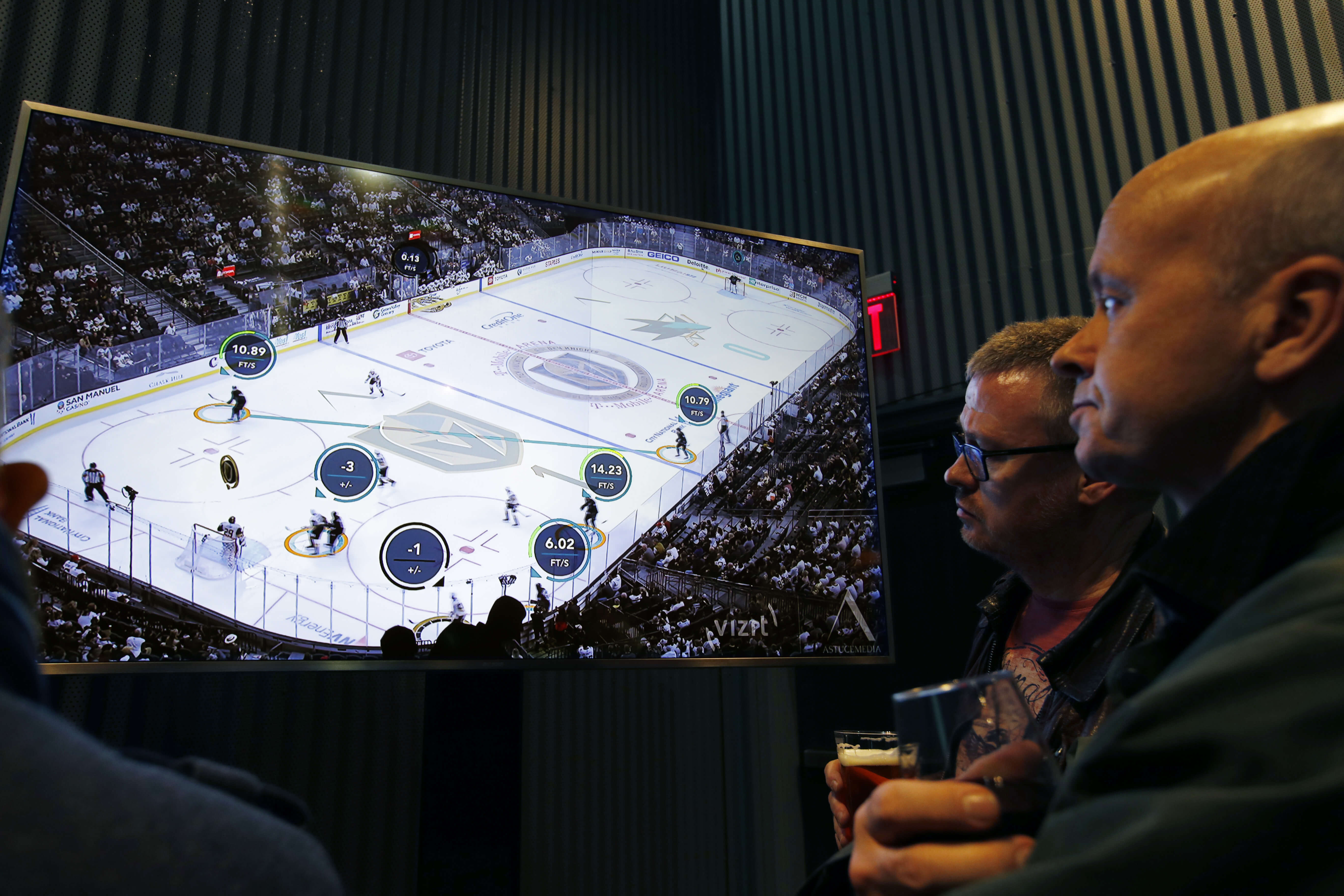 People watch real-time puck and player tracking technology on display during an NHL game between the Vegas Golden Knights and the San Jose Sharks in Las Vegas on Thursday.