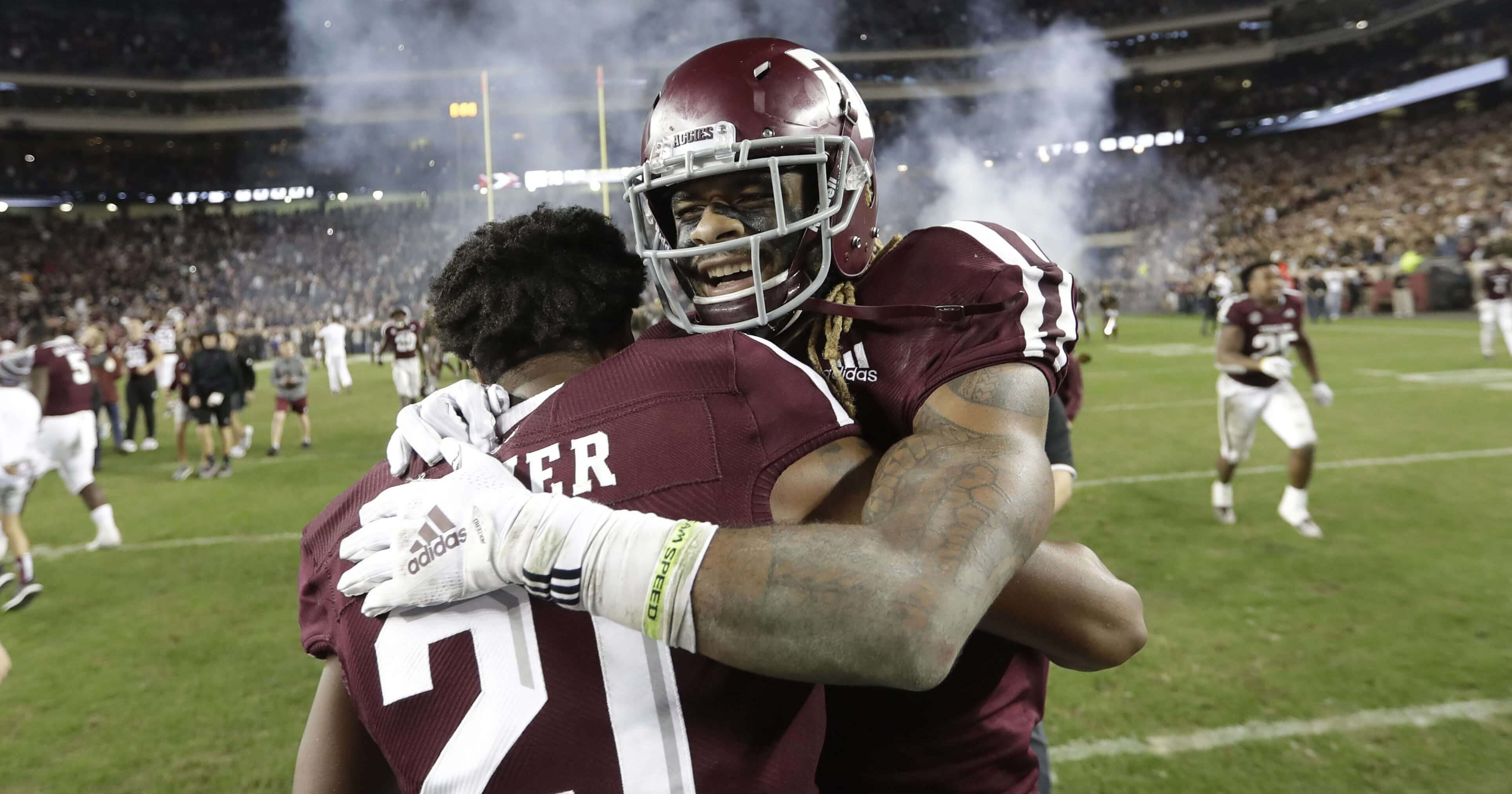 Texas A&M wide receiver Kendrick Rogers, right, celebrates with Charles Oliver after their 74-72 win in seven overtimes against LSU on Nov. 24 in College Station, Texas.
