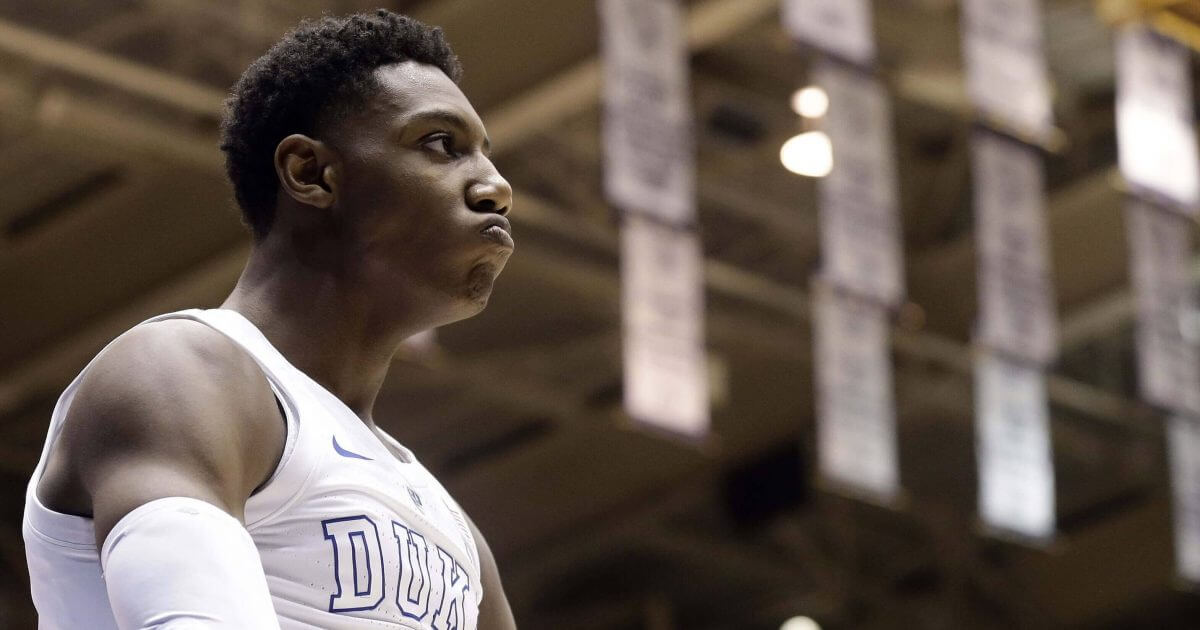 Duke's RJ Barrett reacts following a basket against Virginia during the second half of an NCAA college basketball game in Durham, N.C., on Saturday. Duke won 72-70.