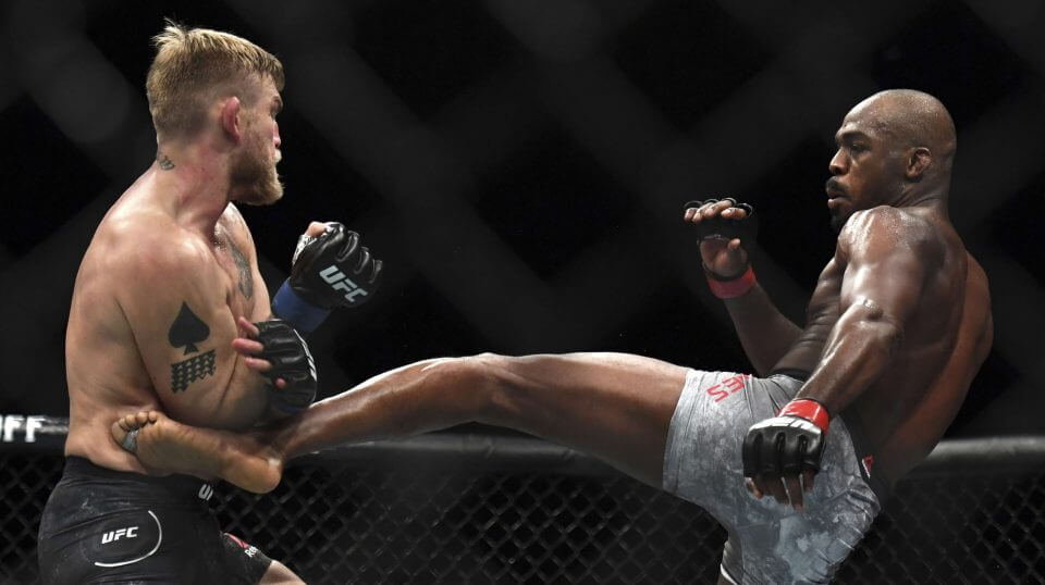 Jon Jones, right, lands a kick to Alexander Gustafsson during the UFC men's light heavyweight mixed martial arts bout Dec. 29 at UFC 232 in Inglewood, California.