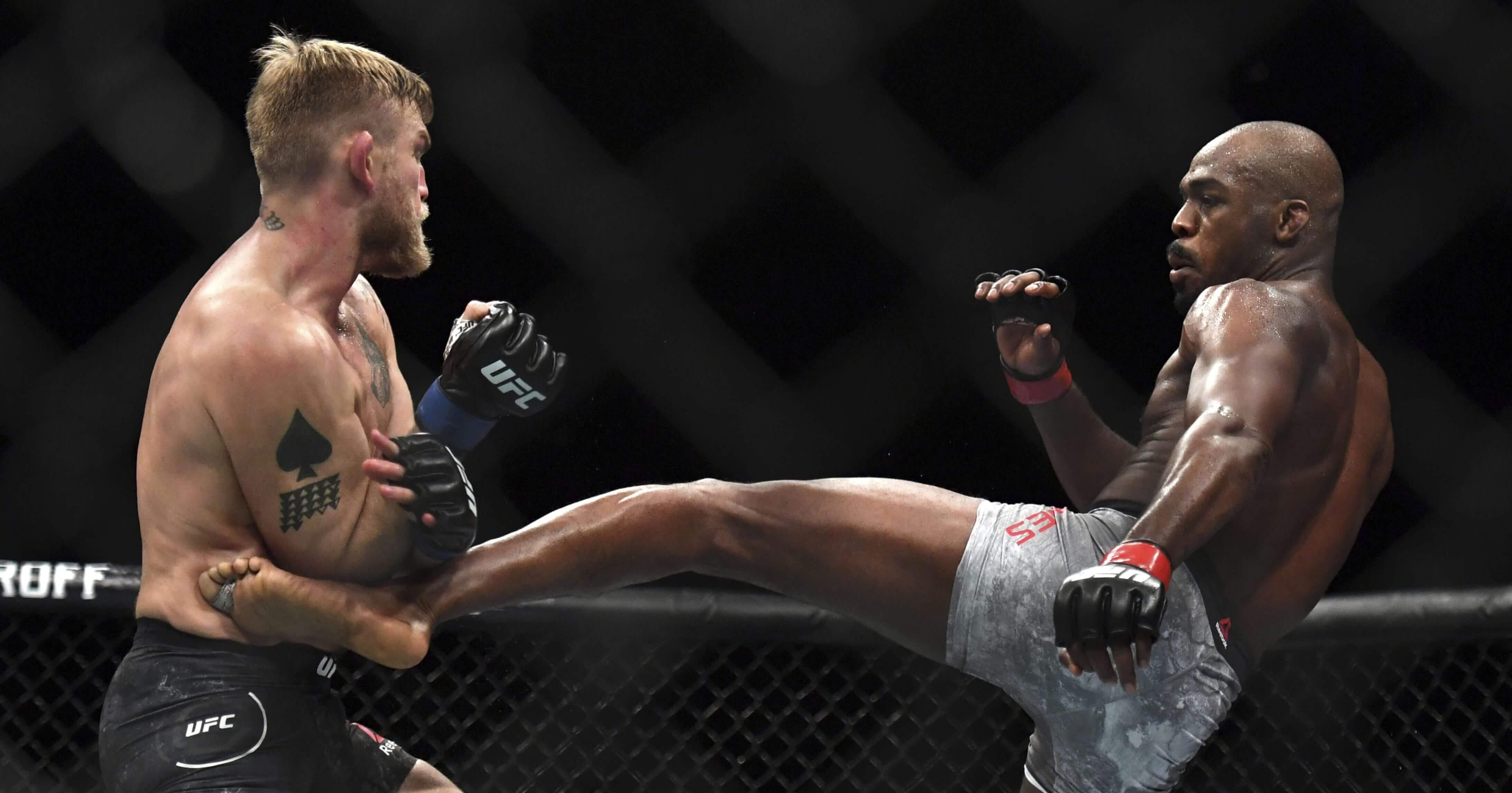 Jon Jones, right, lands a kick to Alexander Gustafsson during the UFC men's light heavyweight mixed martial arts bout Dec. 29 at UFC 232 in Inglewood, California.