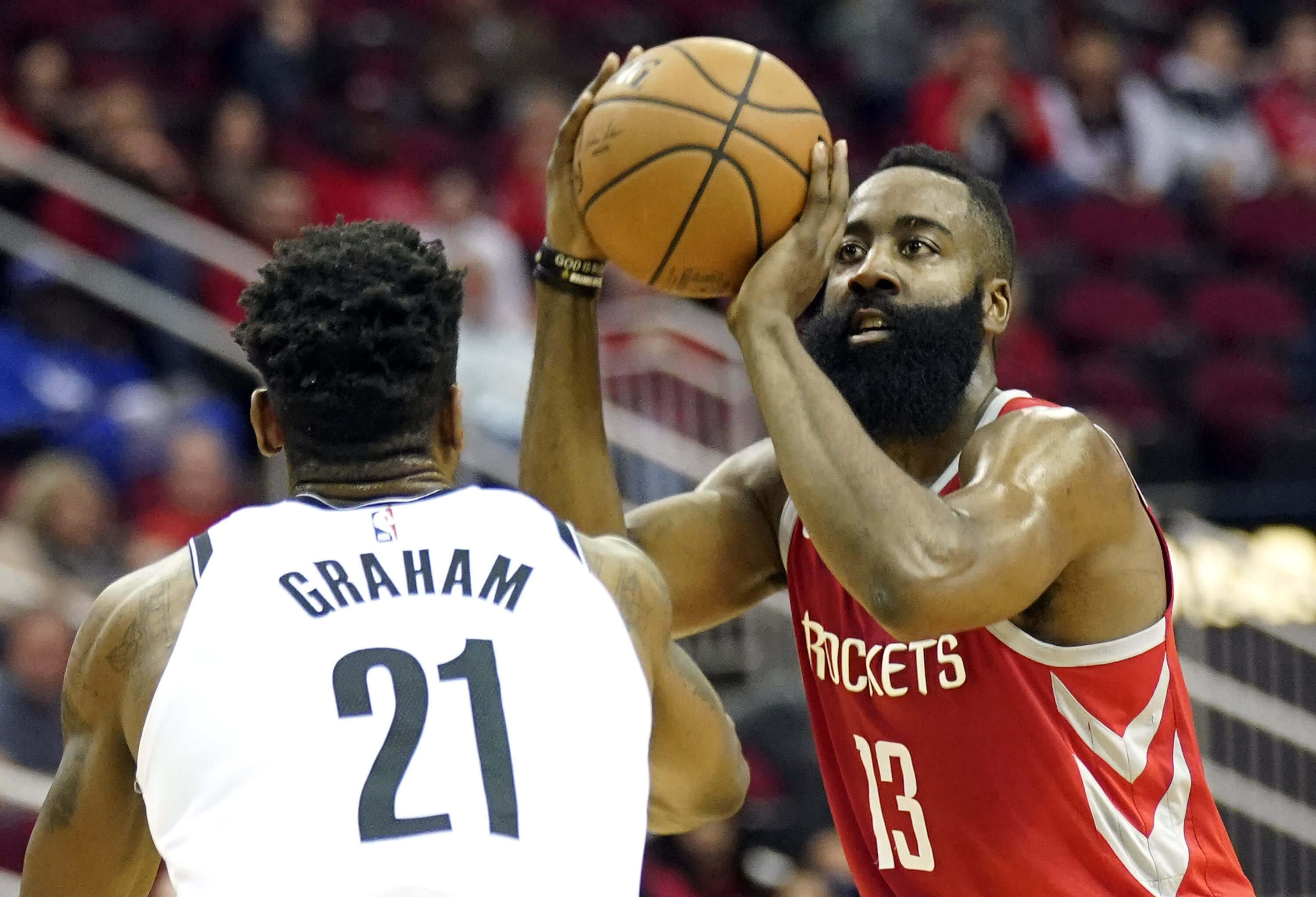 Houston's James Harden shoots as Brooklyn's Treveon Graham defends during the first half Wednesday in Houston.
