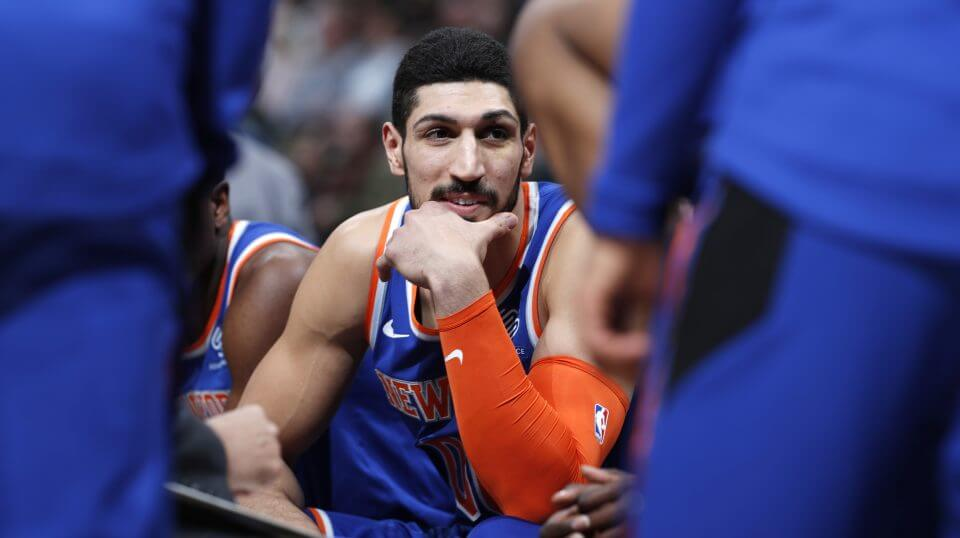 New York Knicks center Enes Kanter jokes with teammates during a timeout in the team's Jan. 1 game against the Denver Nuggets.