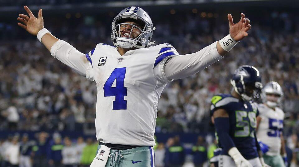 Dallas Cowboys quarterback Dak Prescott (4) celebrates his first down near the goal line against the Seattle Seahawks during the second half of the NFC wild-card NFL football game in Arlington, Texas on Saturday.