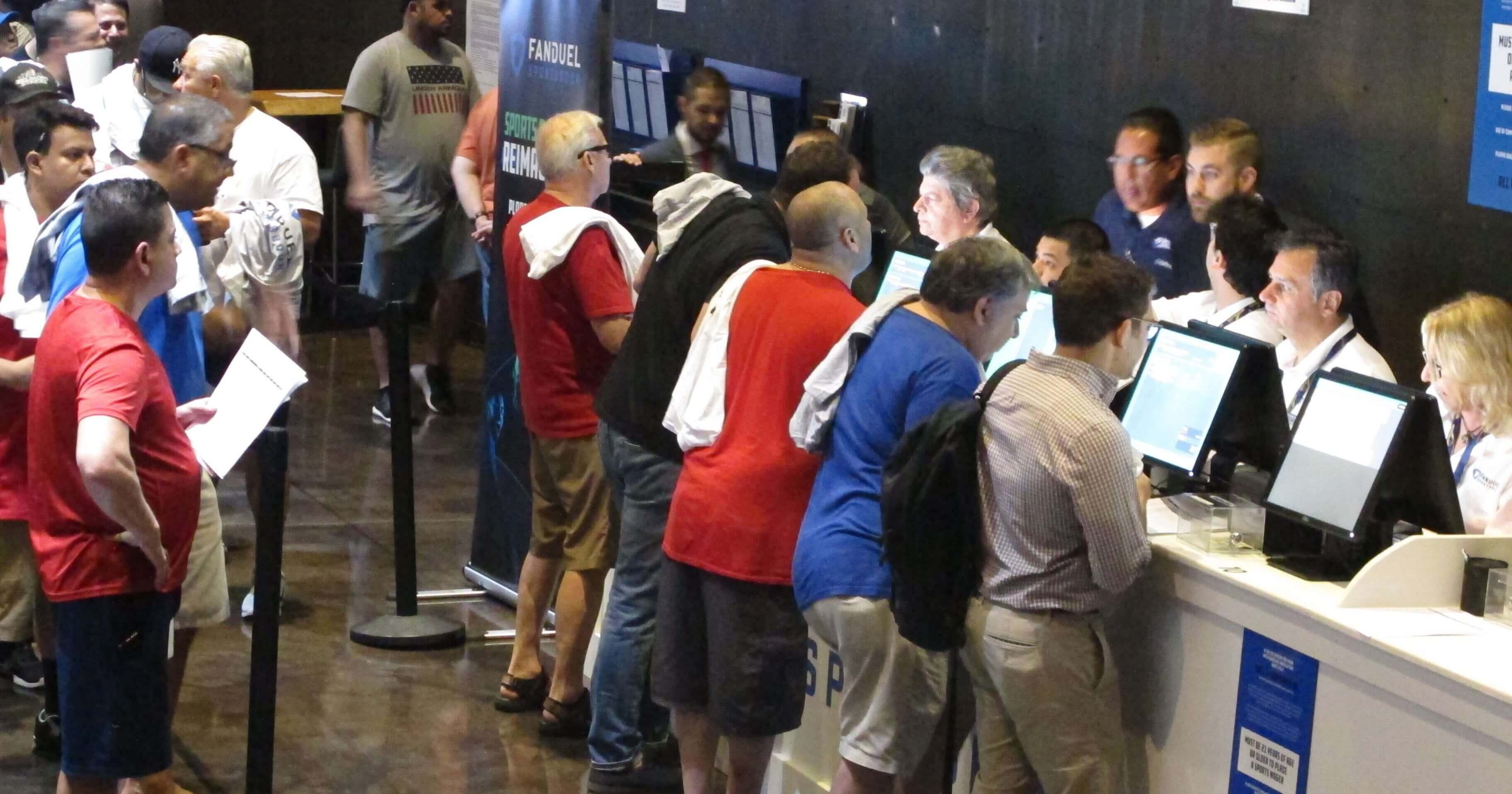 Gamblers place bets on sports events at the FanDuel sports book at the Meadowlands Racetrack in East Rutherford, New Jersey, on July 14.