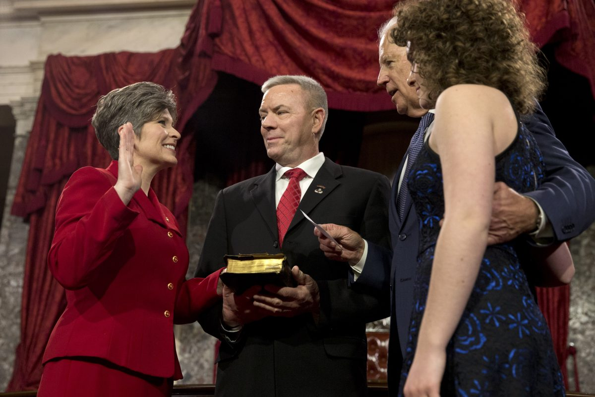 Vice President Joe Biden administers the Senate oath to Sen. Joni Ernst R-Iowa, with her husband Gail Ernst and daughter Elizabeth, during a ceremonial re-enactment swearing-in ceremony in the Old Senate Chamber of Capitol Hill in Washington.