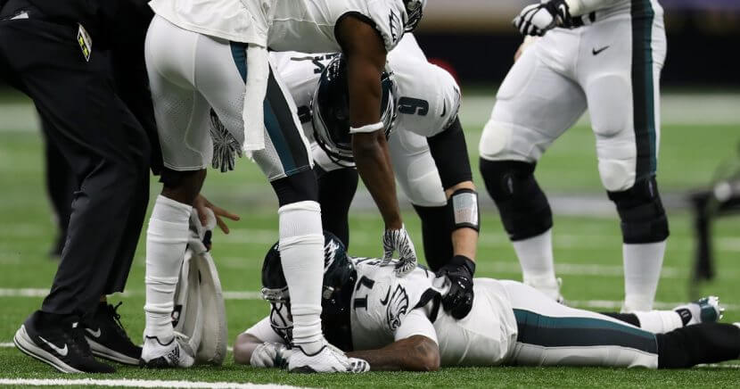 Philadelphia Eagles wide receiver Alshon Jeffery is consoled by his teammates Sunday after he missed a catch at the end of the team's playoff loss to the New Orleans Saints at the Mercedes Benz Superdome.