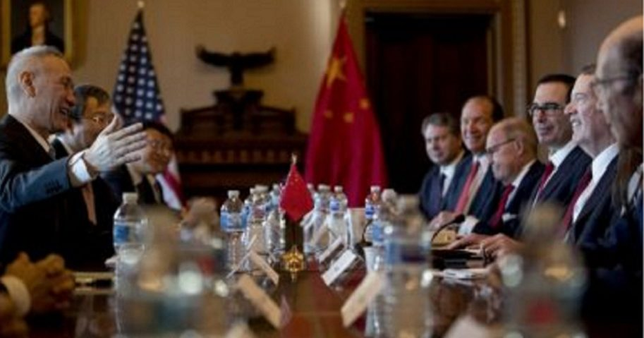 U.S. and Chinese trade representatives meet at a table Wednesday in Washington.