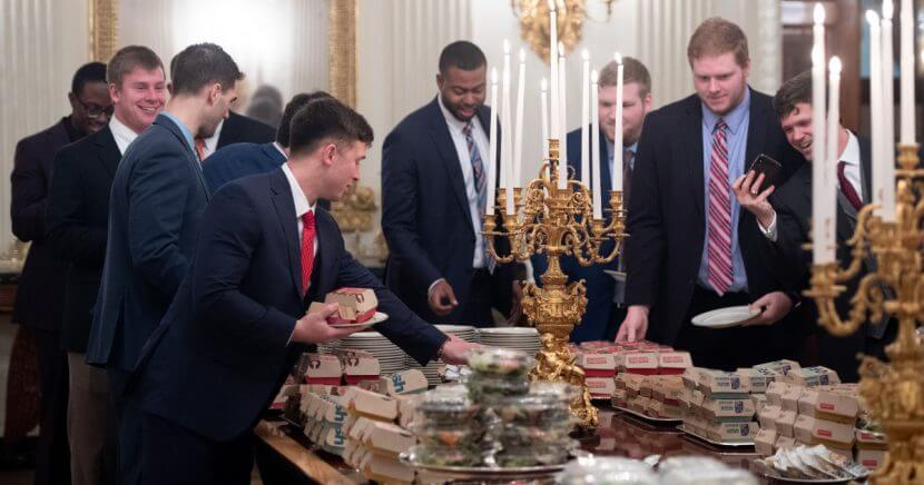 Members of the national champion Clemson Tigers choose from the fast-food options that President Donald Trump purchased for their visit to the White House on Monday.