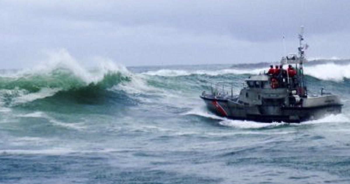A U.S. Coast Guard boat crew responds to three fishermen in the water after the commercial fishing vessel Mary B II capsized while crossing Yaquina Bay Bar on Tuesday off the coast of Newport, Oregon.