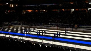 "The NHL's Colorado Avalanche honor fallen police officers by projecting a ""thin blue line"" flag onto the ice before a game Saturday against the Los Angeles Kings."